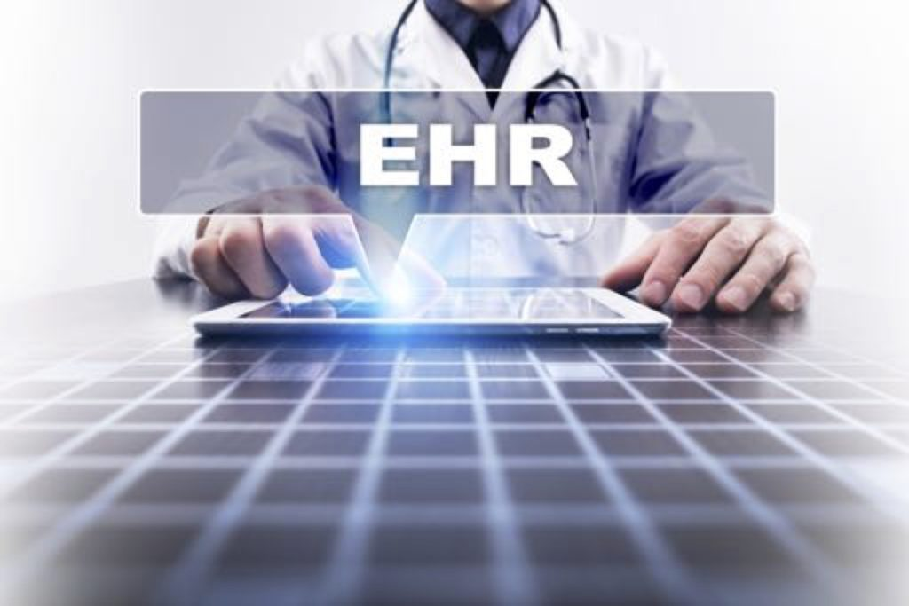 Image of a doctor with a tablet that says EHR
