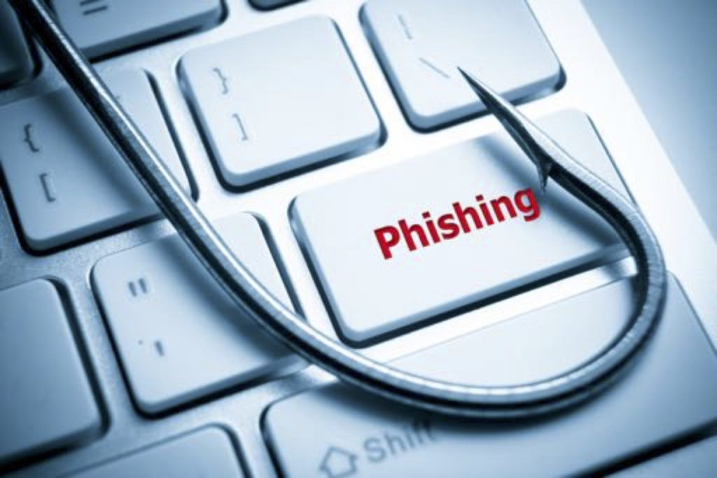 Image of a fishing hook across a keyboard button that says Phishing