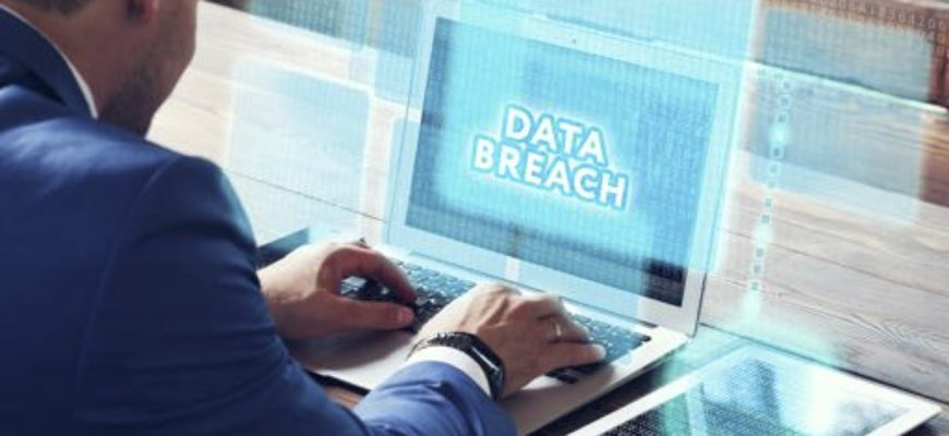 A person on a computer that says Data Breach