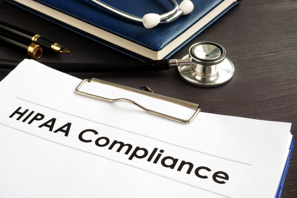 Clipboard that says HIPAA Compliance