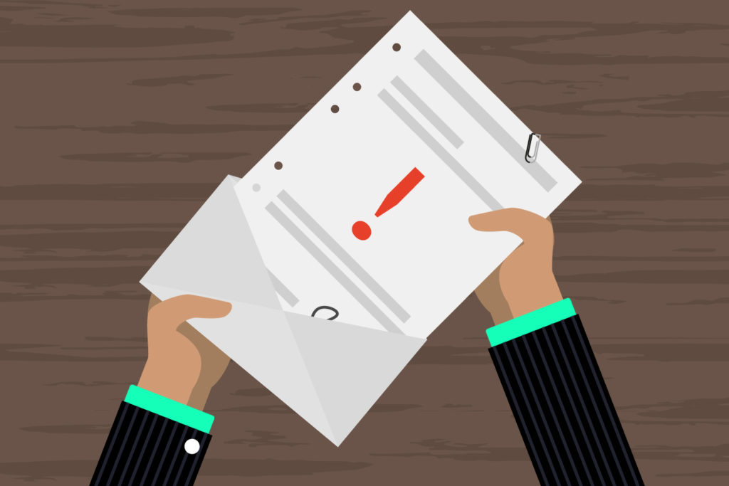 Image of a person opening a notification letter
